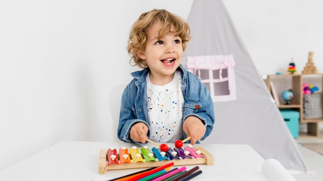 Front view of boy playing with xylophone