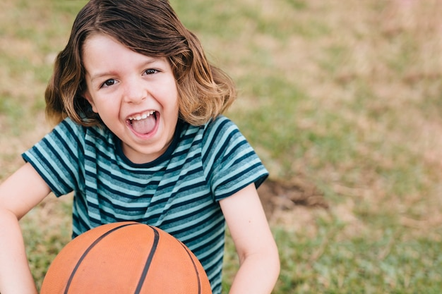 Front view of boy with basketball