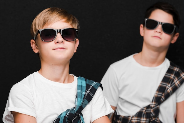 Front view of boys with sunglasses
