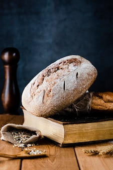 Front view of bread on a boon on wooden table
