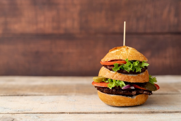 Front view burger with wooden background