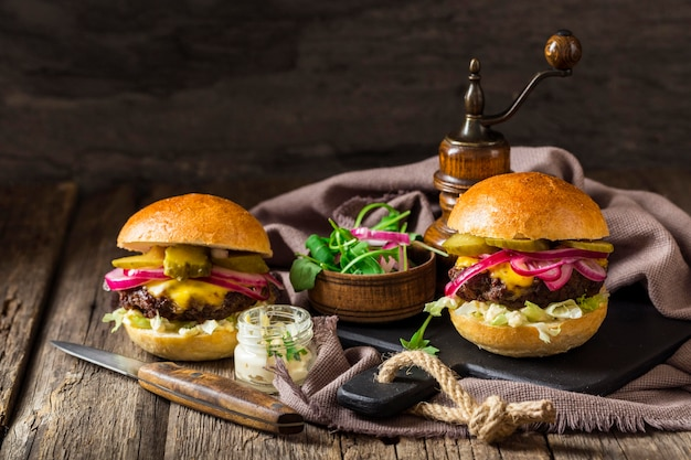 Front view burgers with pickles
