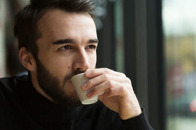 Front view business man drinking coffee