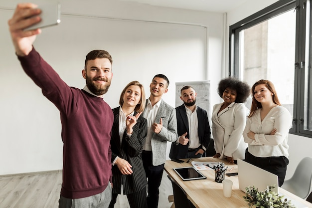 Front view of business people taking a selfie