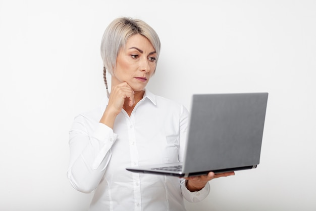 Front view business woman holding laptop