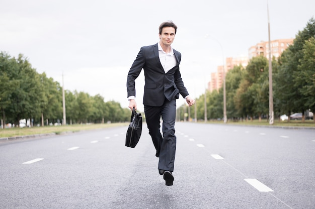 Front view of businessman running