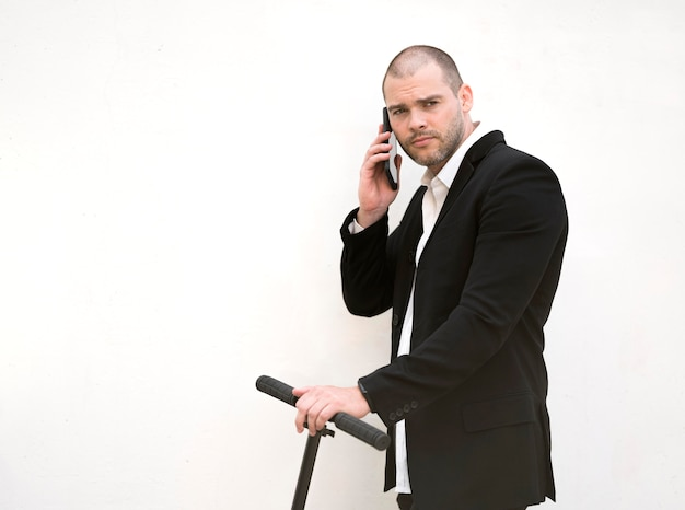 Front view businessman talking on the phone