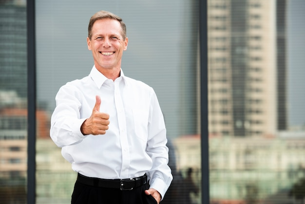 Front view businessman thumbs up gesture