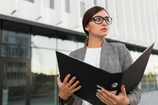 Front view of businesswoman holding binder