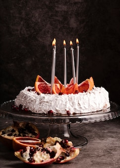 Front view of cake with candles and fruit