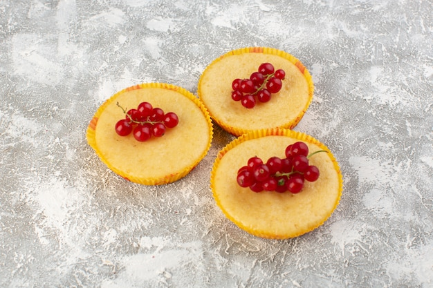 Front view of cake with cranberries delicious and perfectly baked on the grey surface