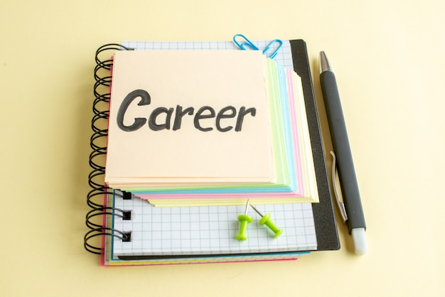 Front view career written note with colorful paper notes on light background