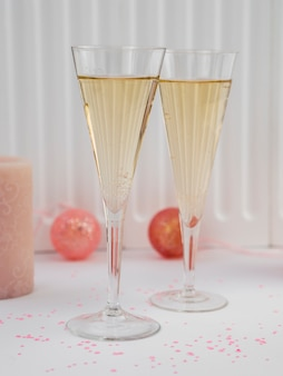 Front view of champagne glasses and pink globes