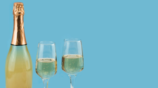 Front view of  champagne and glasses with copy space