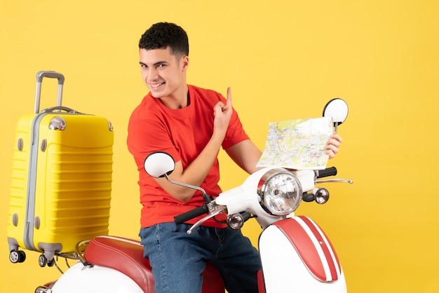 Front view cheerful young man on moped holding map
