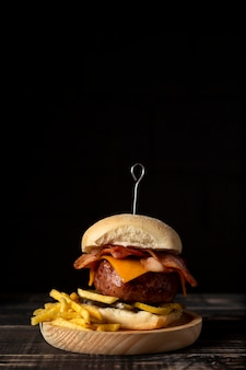 Front view cheeseburger and fries with copy-space
