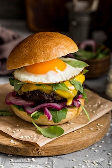 Front view cheeseburger with fried egg