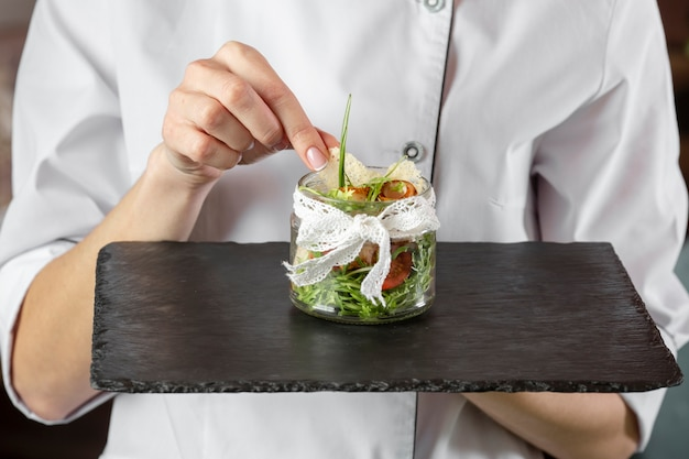 Front view of chef holding delicious food