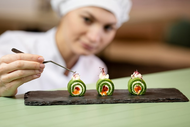 Front view of chef making a plating