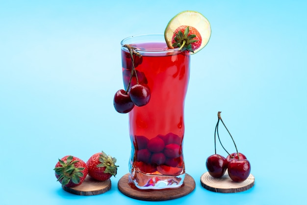 A front view cherry cocktail with fresh red fruits ice cooling on blue, drink juice cocktail fruit color