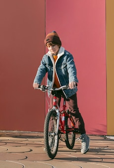 Front view of child on bike outdoors