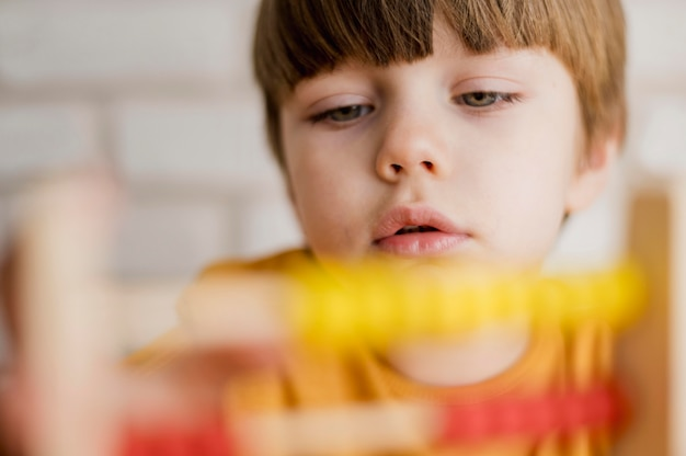 Front view of child using abacus