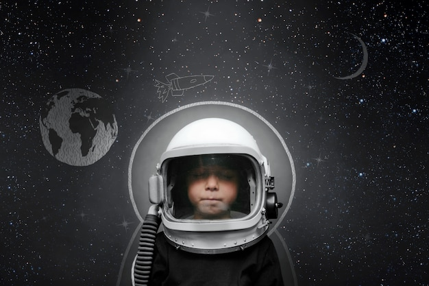 Front view of a child wearing an astronaut helmet