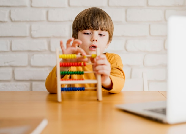 Front view of child with abacus at desk