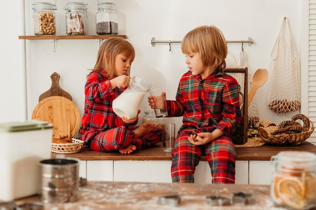 Front view children drinking milk