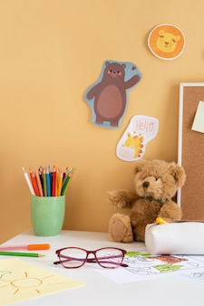 Front view of children's desk with teddy bear and glasses