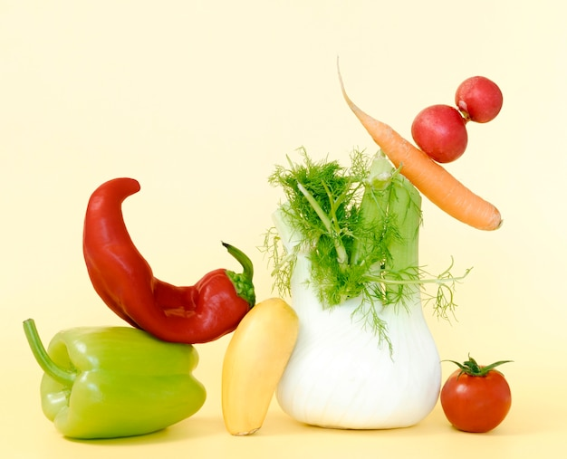 Front view of chili pepper with radish and carrot