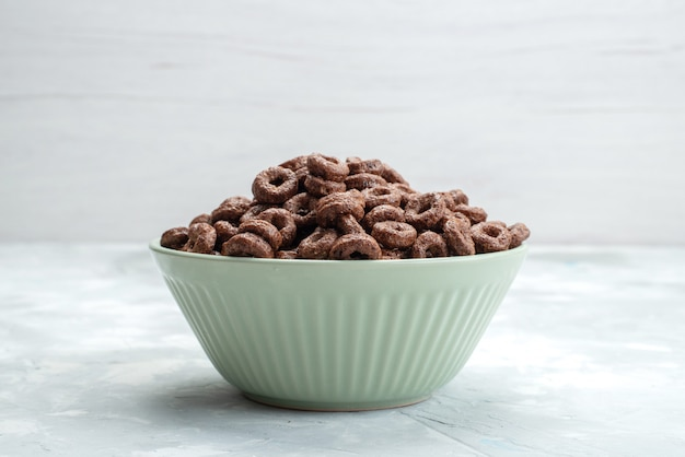 Front view chocolate cereals inside green plate breakfast food meal cacao