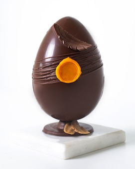 Front view chocolate egg beautiful whole on the white floor