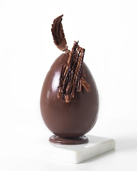 Front view chocolate egg on the white floor