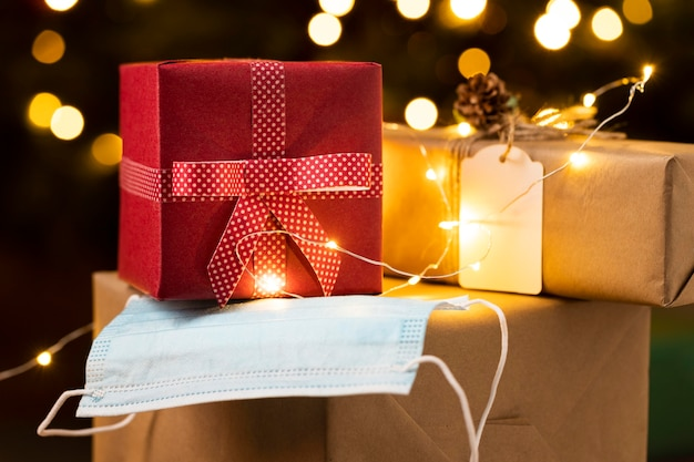 Front view of christmas gifts with face mask