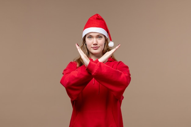 Front view christmas girl showing ban sign on brown background model holiday christmas