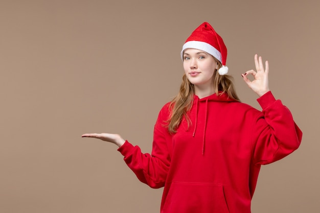 Front view christmas girl smiling on a brown background holiday new year christmas