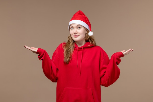 茶色の背景モデルの休日のクリスマスを考えて正面図のクリスマスの女の子