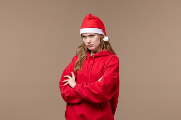 Front view christmas girl with mad face on a brown background holiday new year christmas