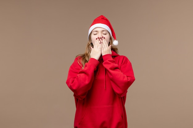 Front view christmas girl yawning on brown background woman holidays christmas