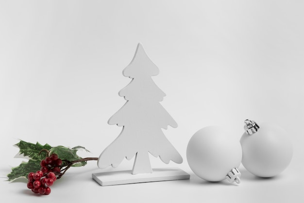 Front view of christmas ornaments with baubles and tree