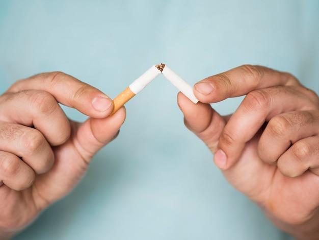 Front view of cigarette bad habit concept