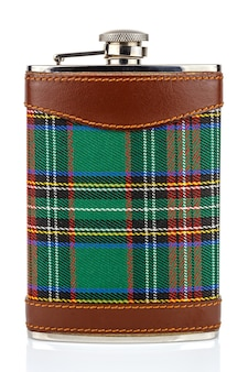 Front view of classical scotland pewter hip flask with leather and tartan trim isolated on white background