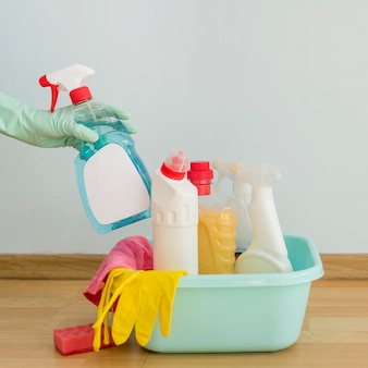 Front view of cleaning supplies in bucket