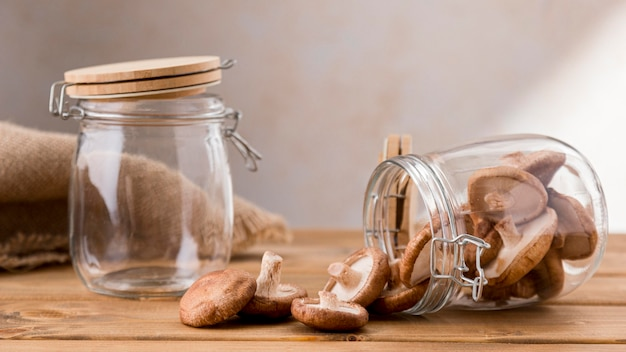 Front view of clear jars with mushrooms