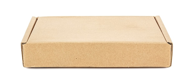 Front view of closed flat brown carton box on white
