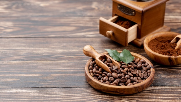 Front view of coffee concept on wooden table