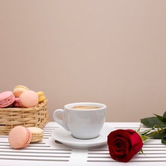 Front view of coffee cup and rose valentines day with copy space