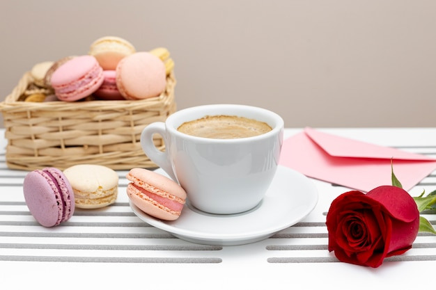 Front view of coffee cup with rose for valentines day