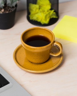 Front view of coffee on desk concept